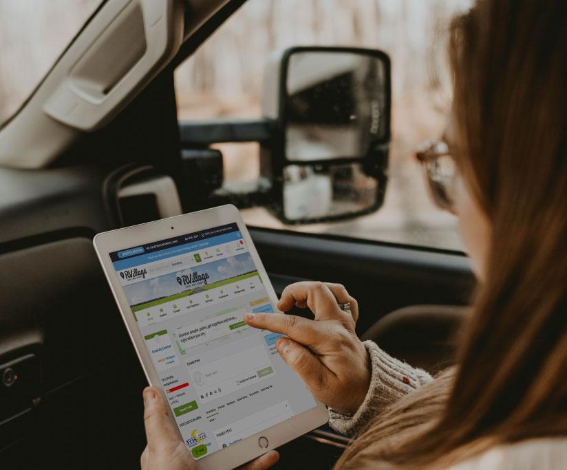 woman using ipad to access RVillage