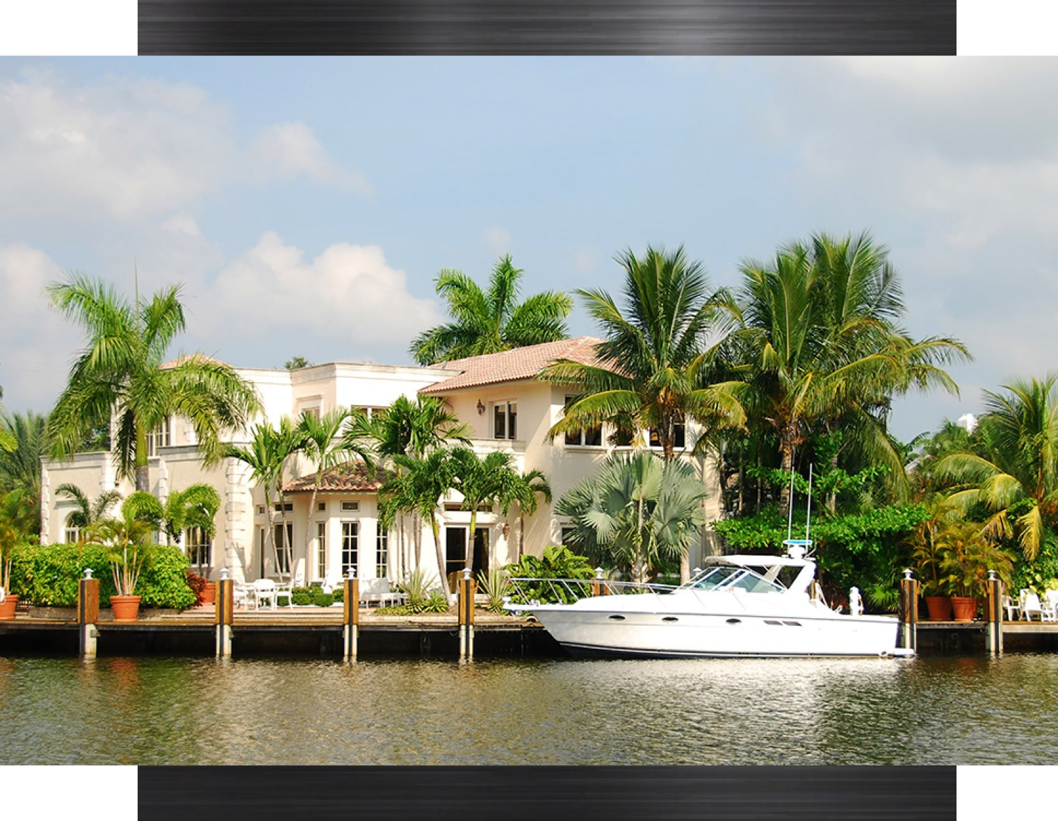 a waterfront home with a yacht
