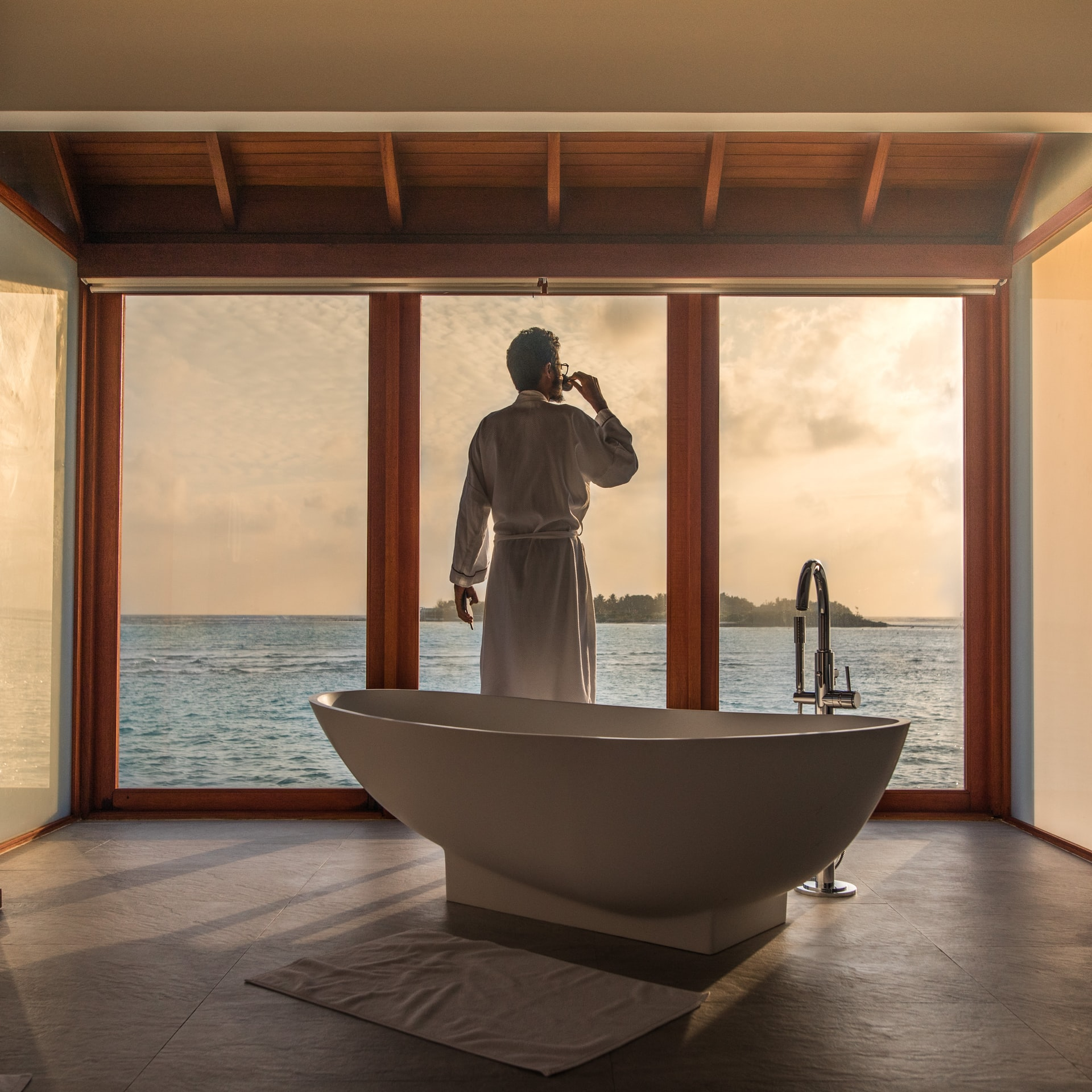a luxurious bathroom with a view of the ocean
