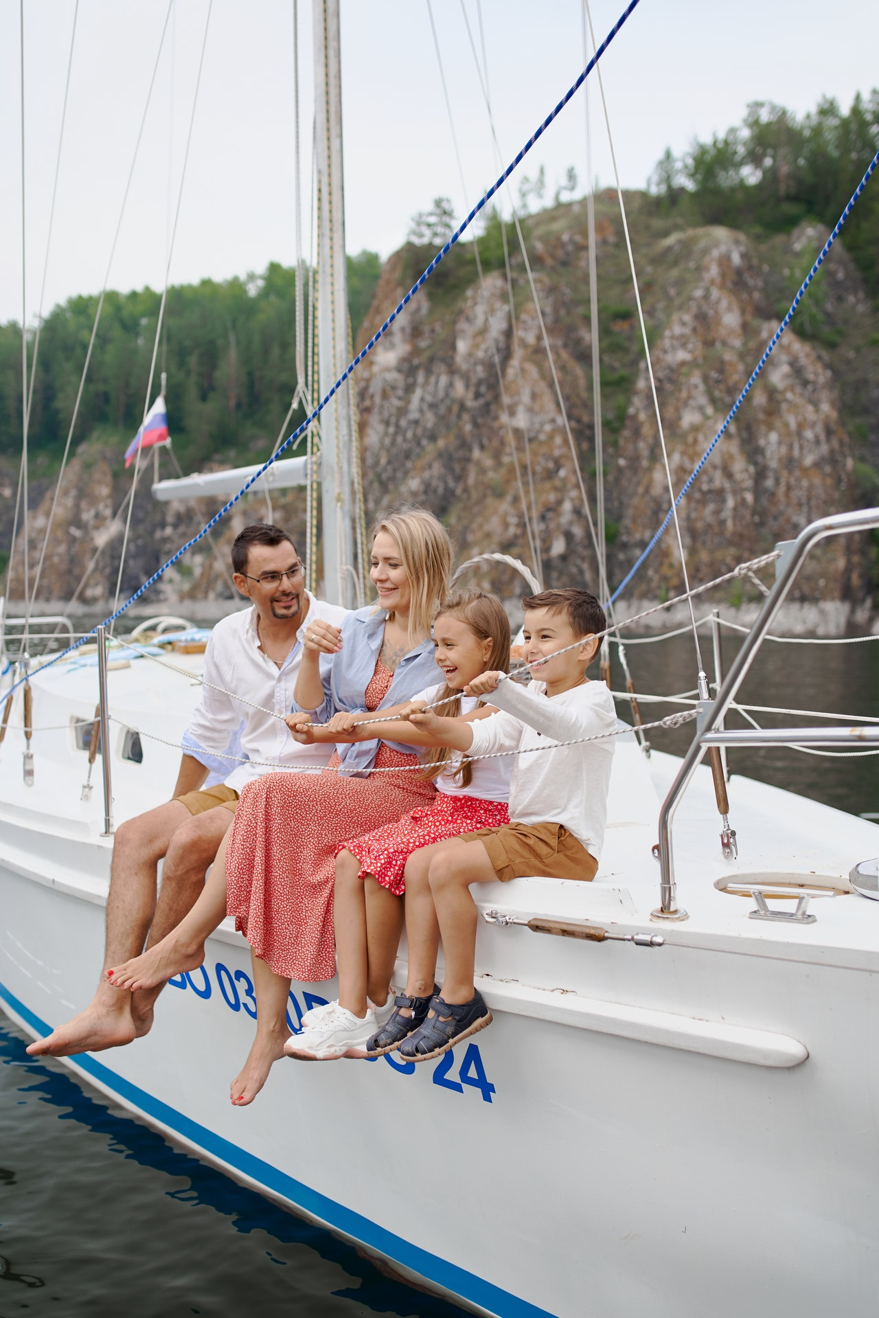 a family on a sailboat
