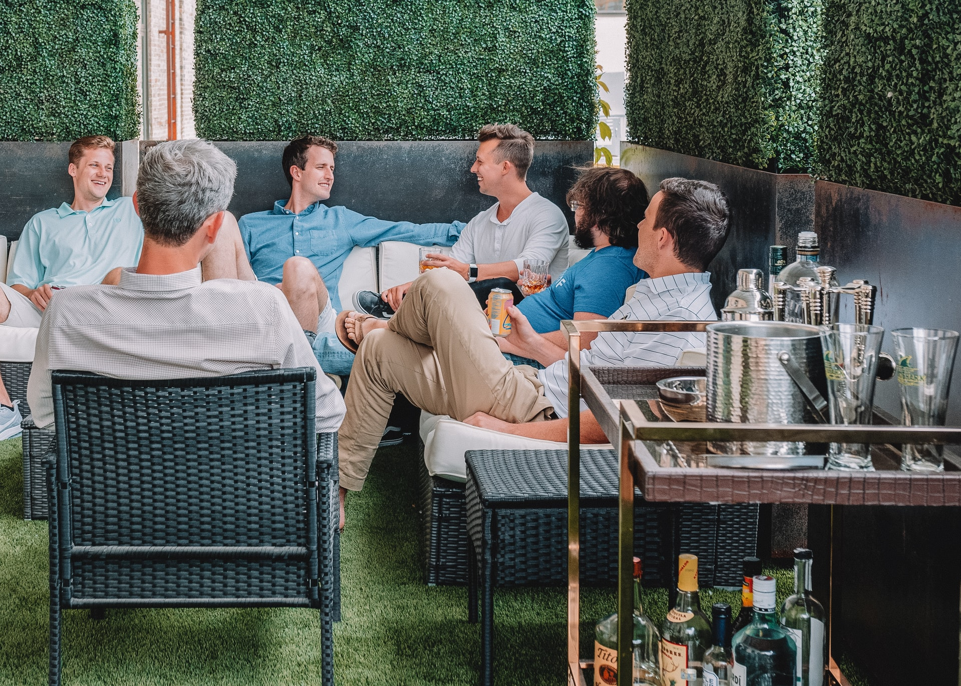 a group of men sitting around and talking