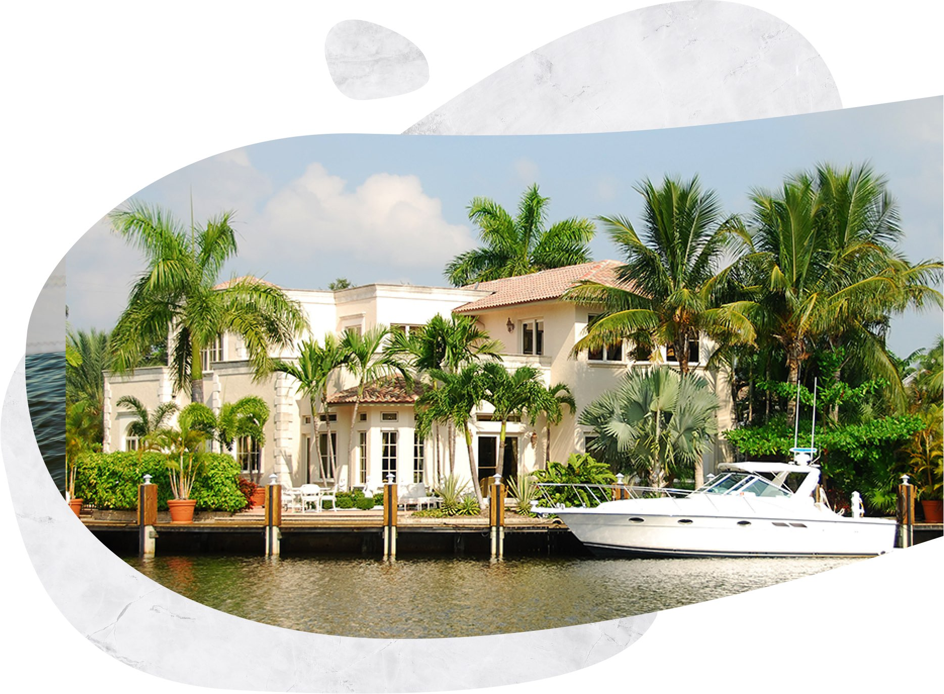 a waterfront home with a boat