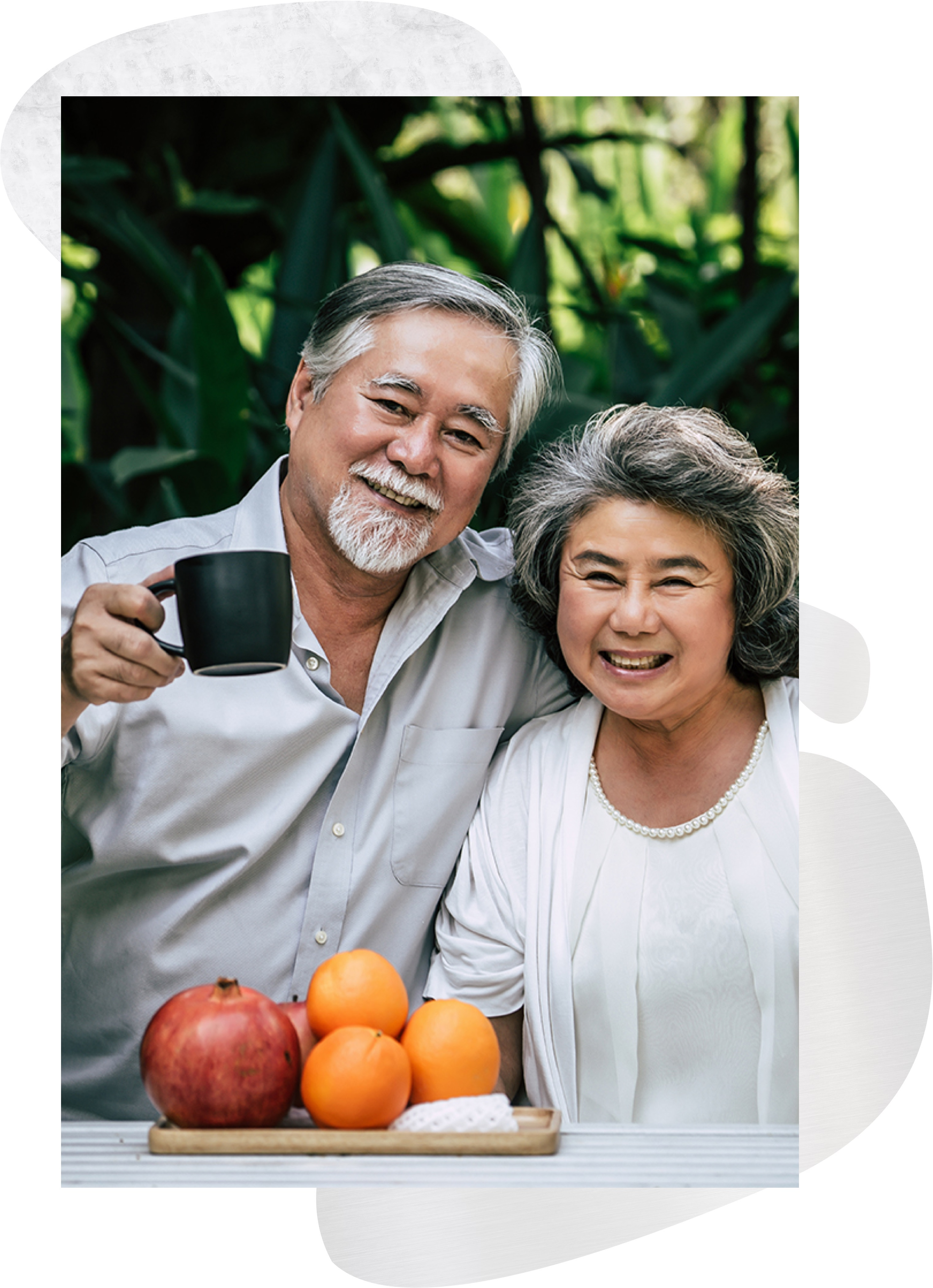 a couple smiling and having coffee