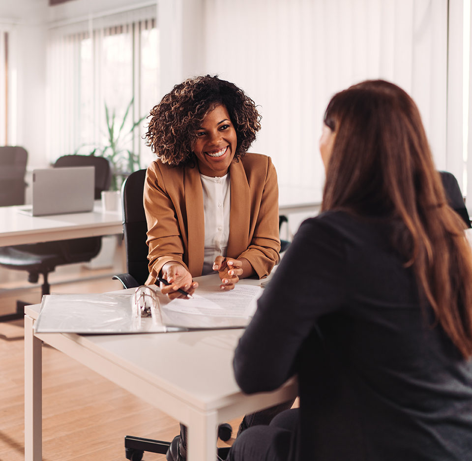 two business women reviewing paperwork