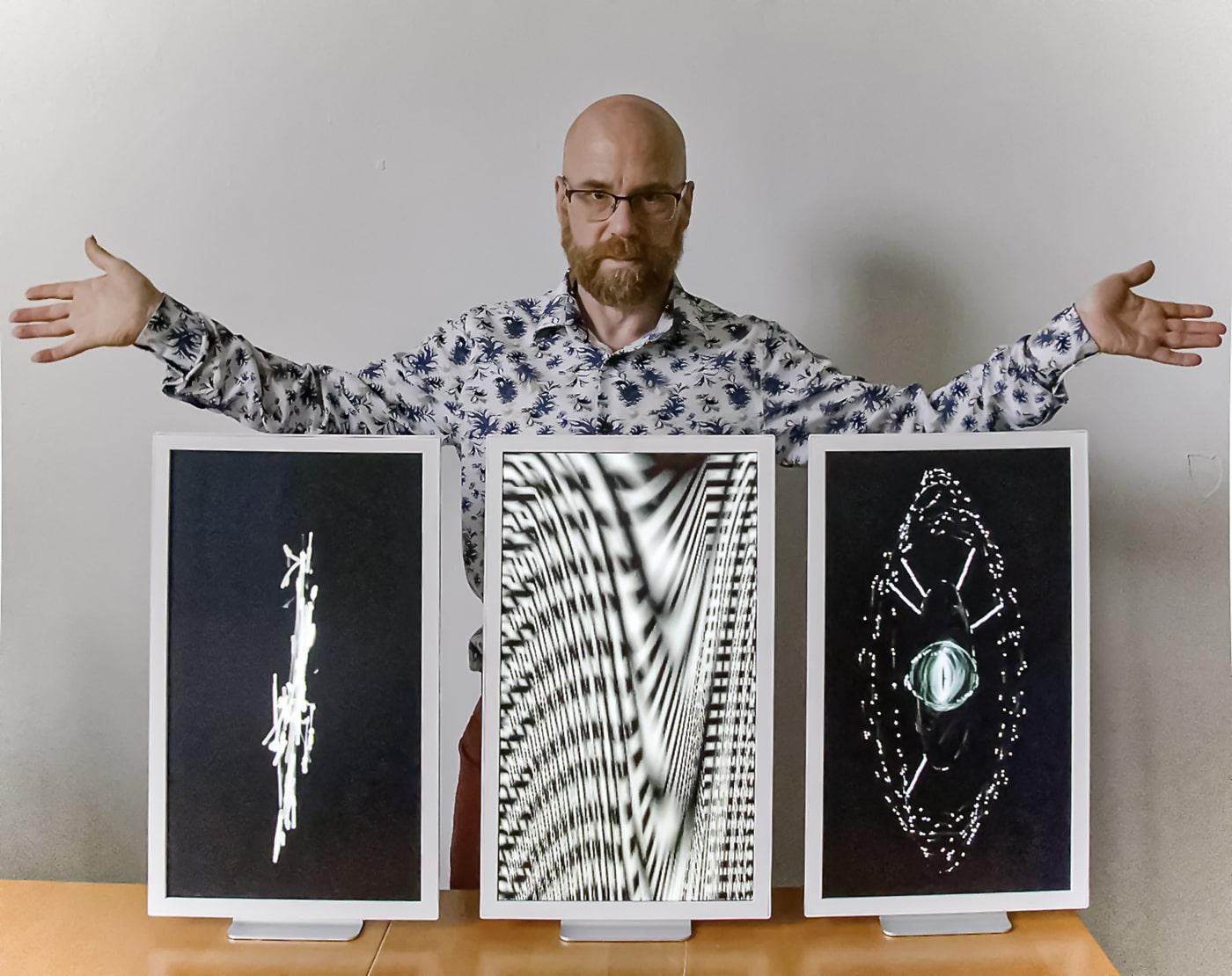Benton C Bainbridge with 3 of his media artworks.