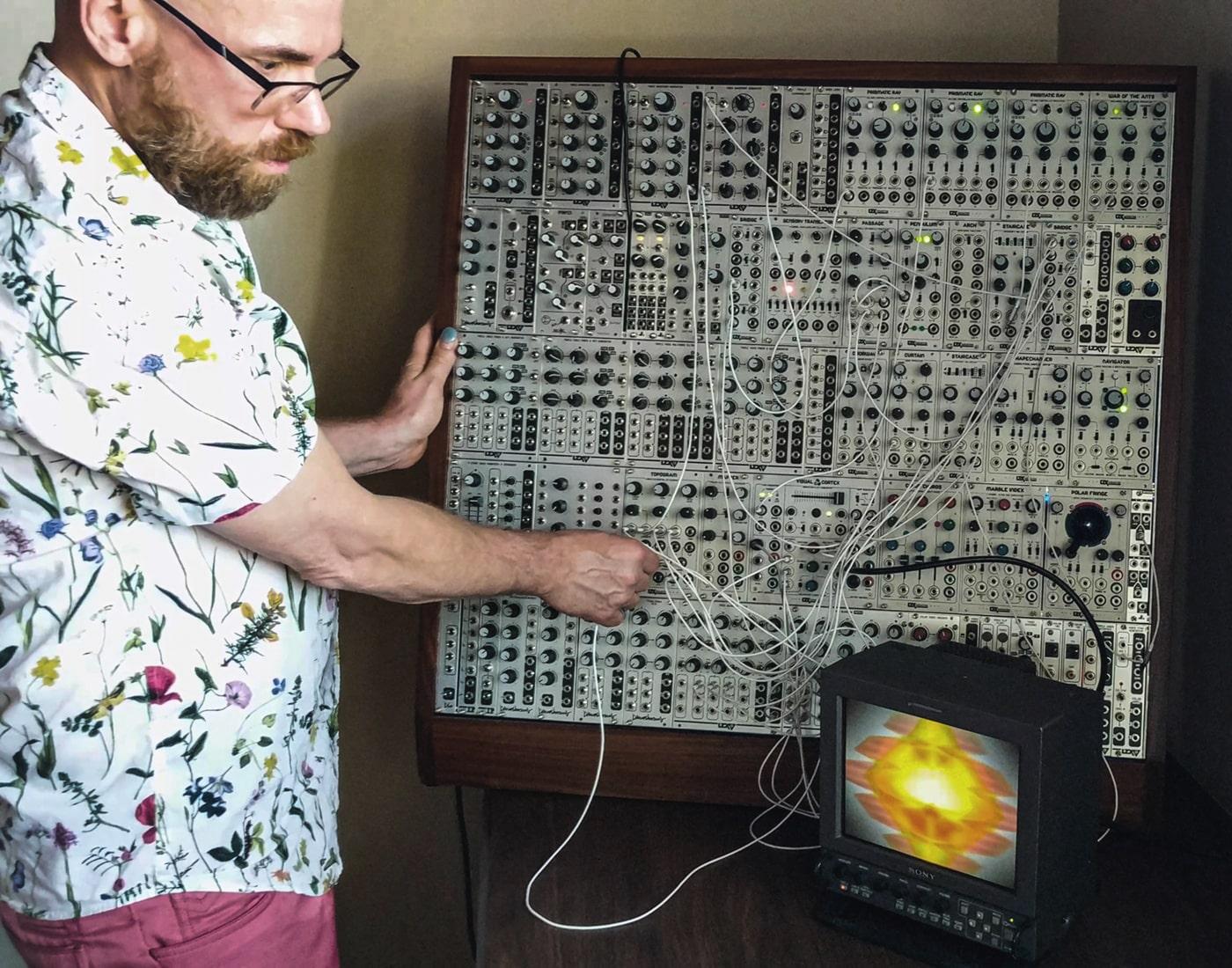Benton C Bainbridge operating his video synth.