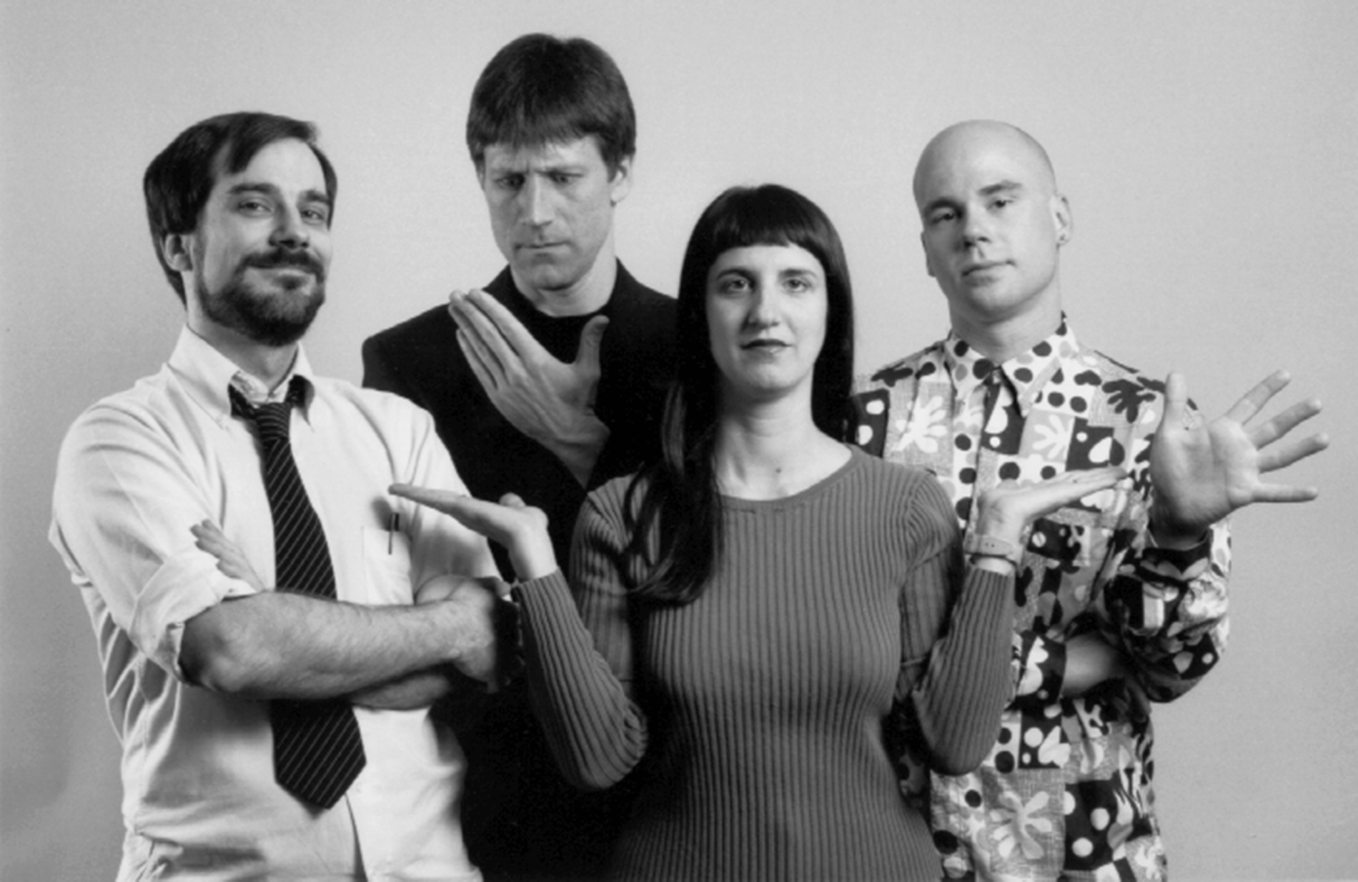 A black & white PR photo of live video performance ensemble 77 Hz taken in 1995. Pictured are members (left-to-right) Michael Schell, Nick Didkovsky, Nancy Meli Walker, and Benton C Bainbridge.