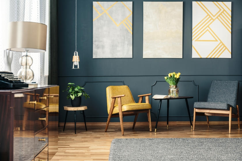 Dark green living room with yellow and gold accents