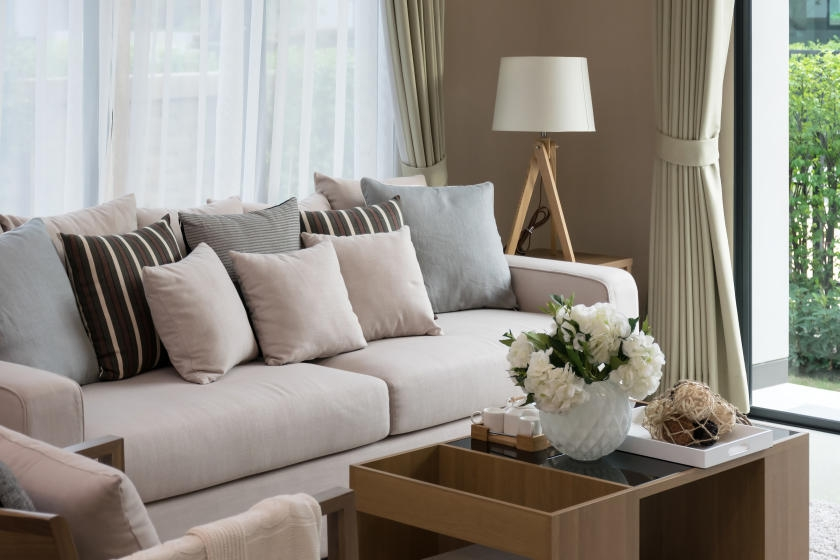 Plush living room with brown beige walls