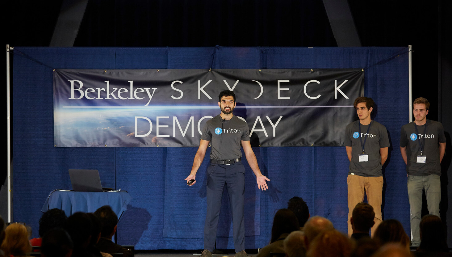 Simba speaking in front of a crowd at UC Berkeley Skydeck's Demo Day