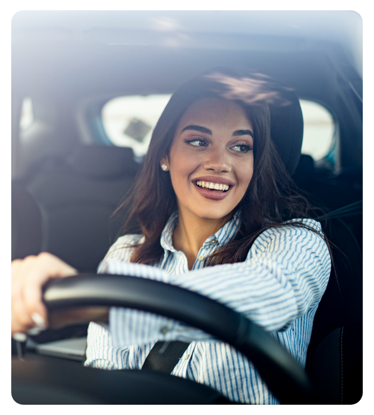 Female driver smiling while completing gig driving job