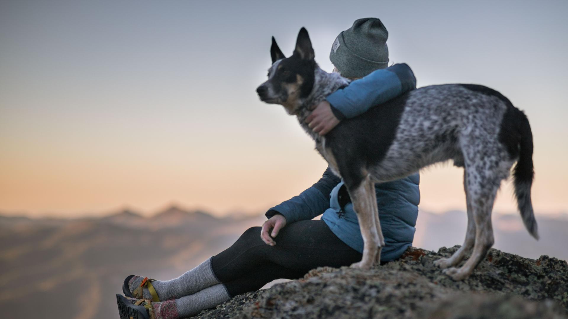 woman hiking with ESA dog