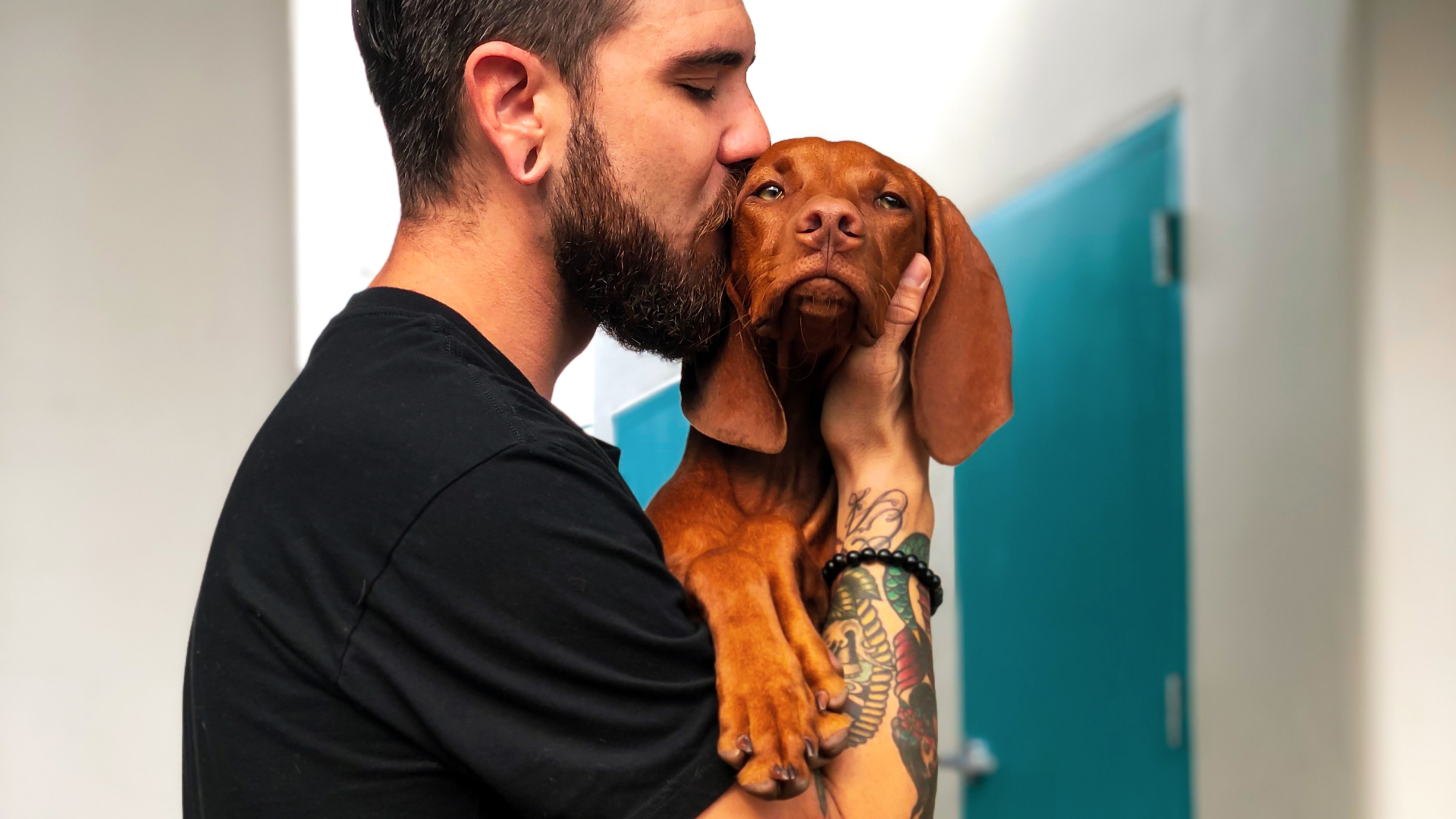 man hugging emotional support dog