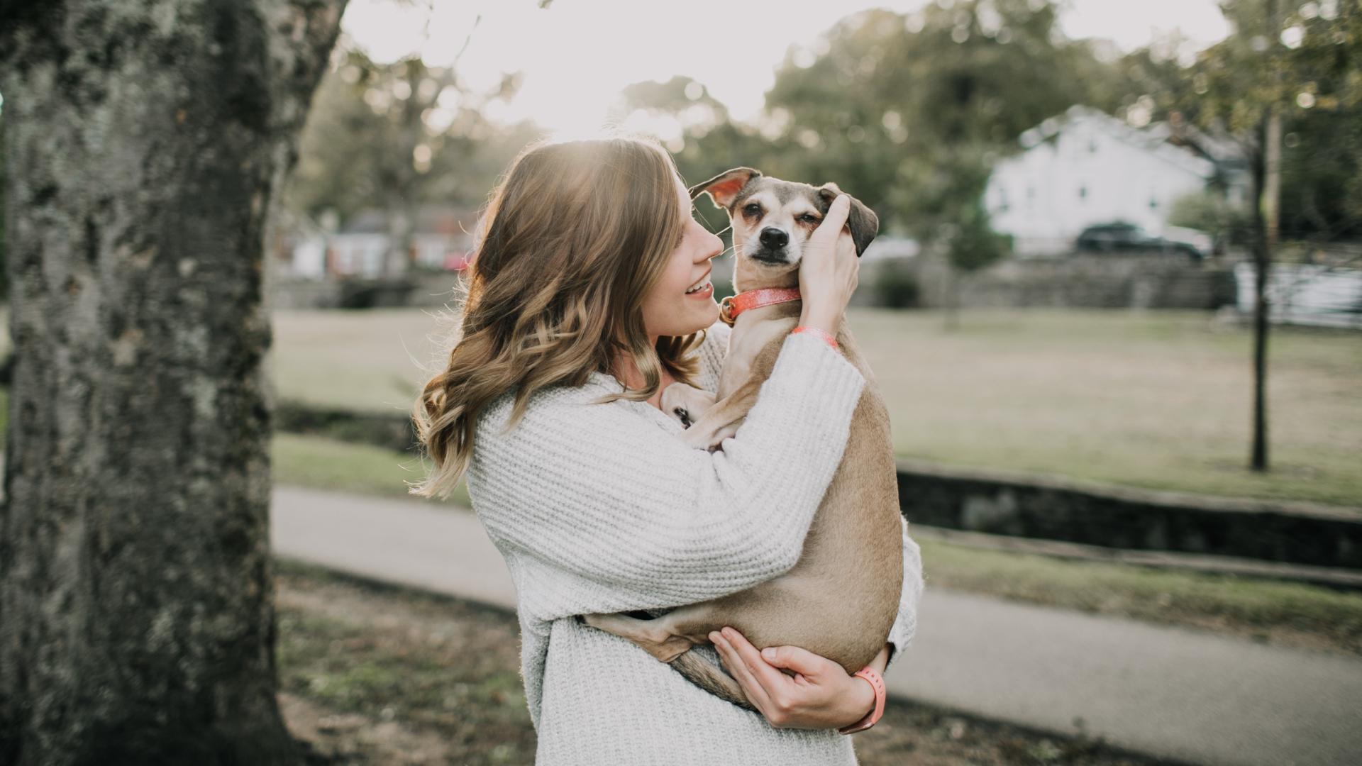 woman hugging emotional support dog