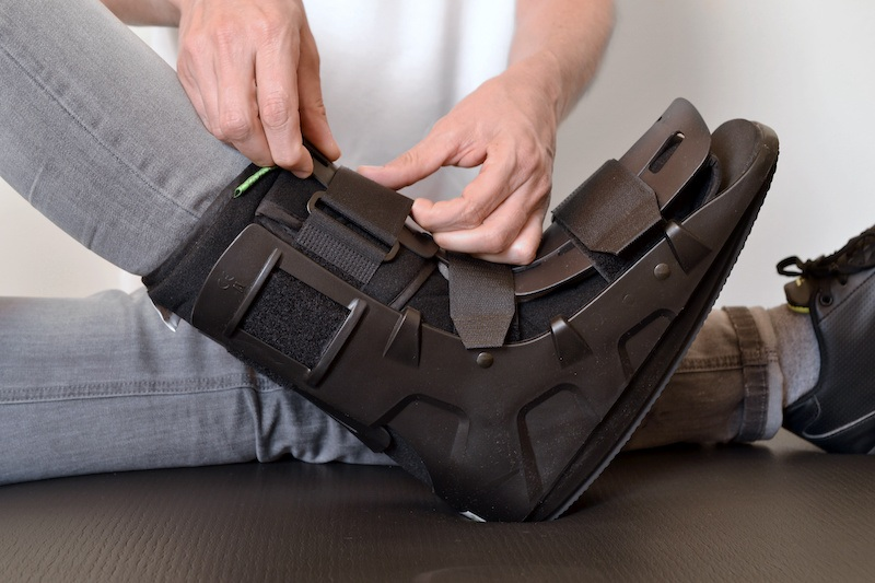 person wearing controlled ankle movement boot for foot injury