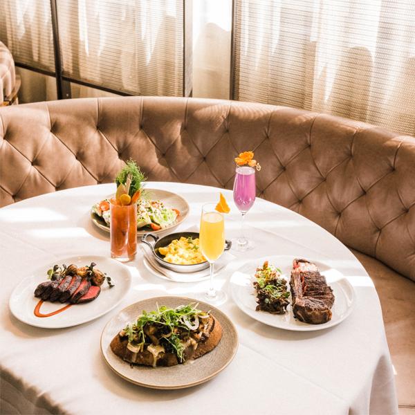 steak dinner on white table