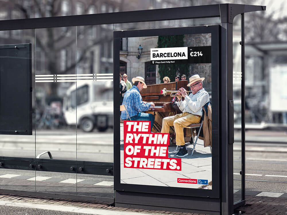 A busstop with Connections poster