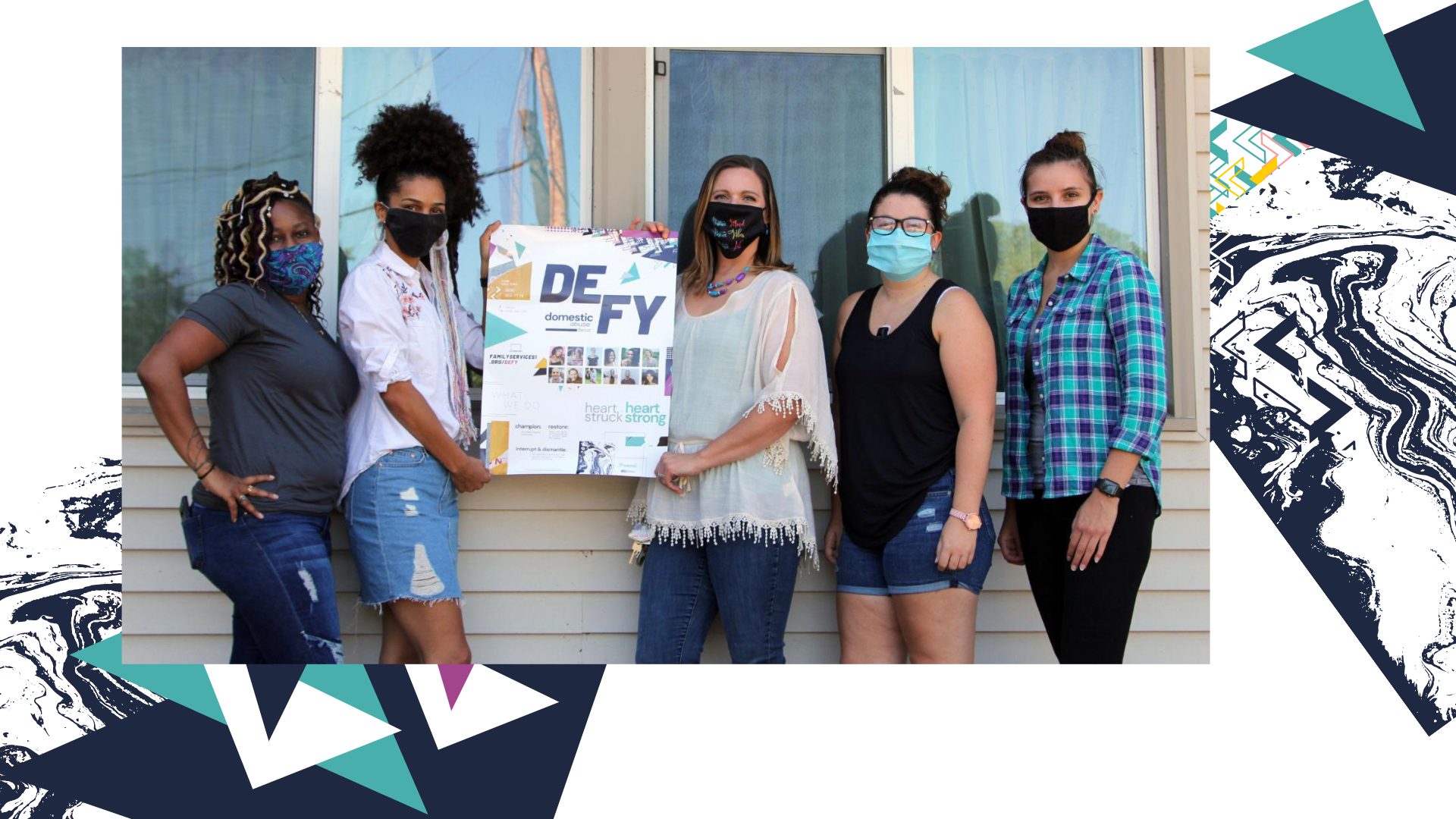 A photo of advocacy staff holding a poster advertisement made for Defy Domestic Abuse Beloit as part of their marketing project with Owl Street Studio.