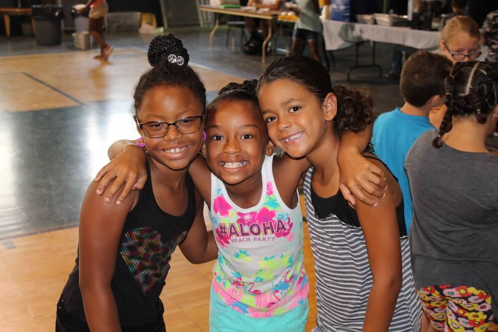 Photo of three kids smiling and having fun at the lemoyne community center