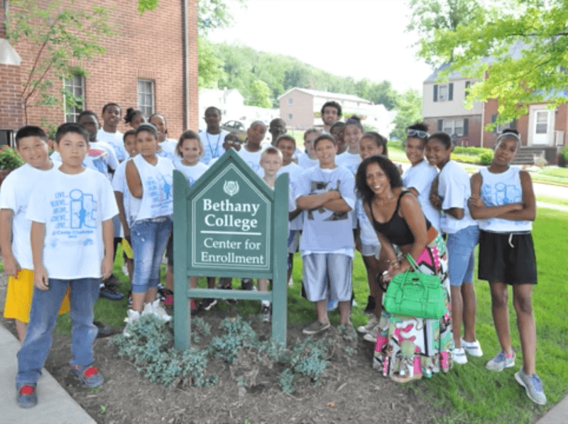 Group of kids taking a photo at Bethany college center for enrollment