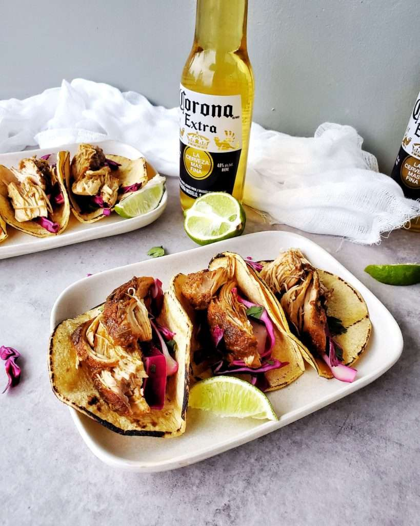 Chicken Tacos on a plate with beer