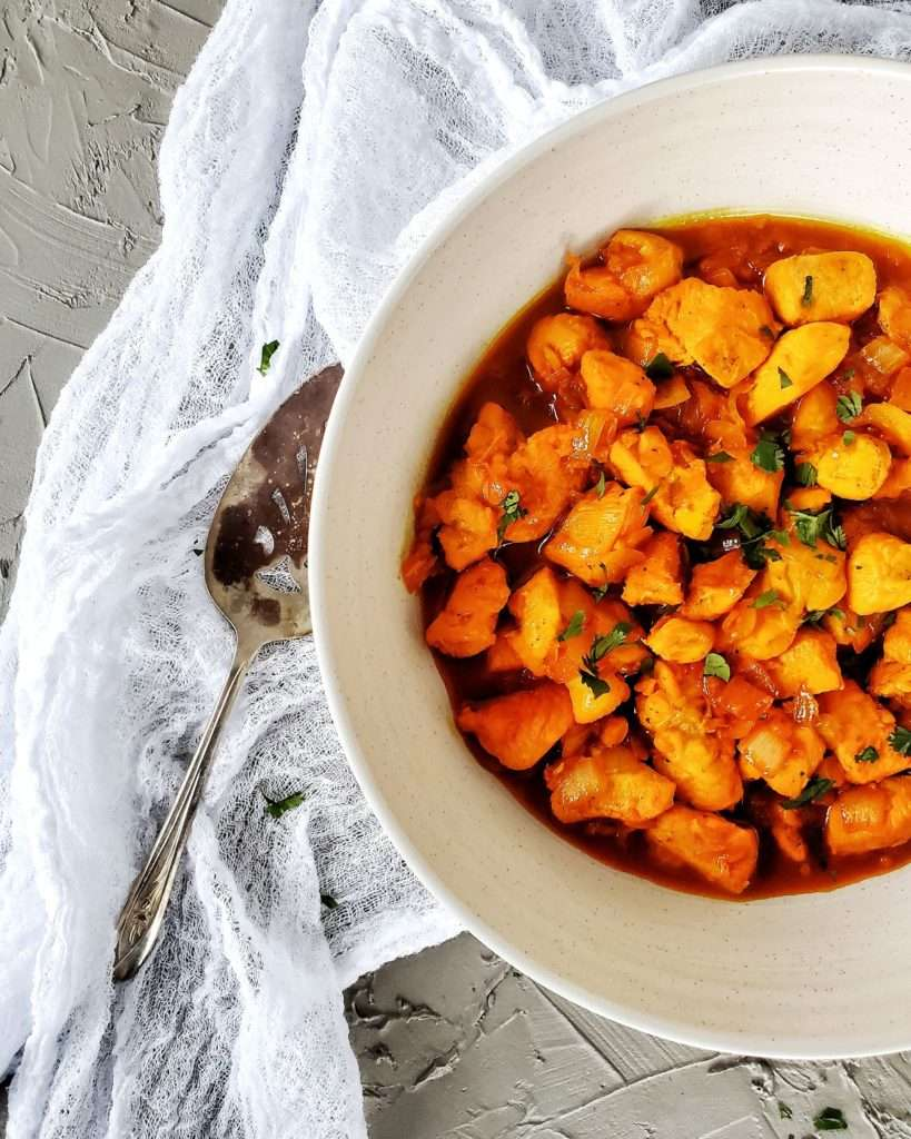 Easy Portuguese Chicken Mozambique in Serving Bowl