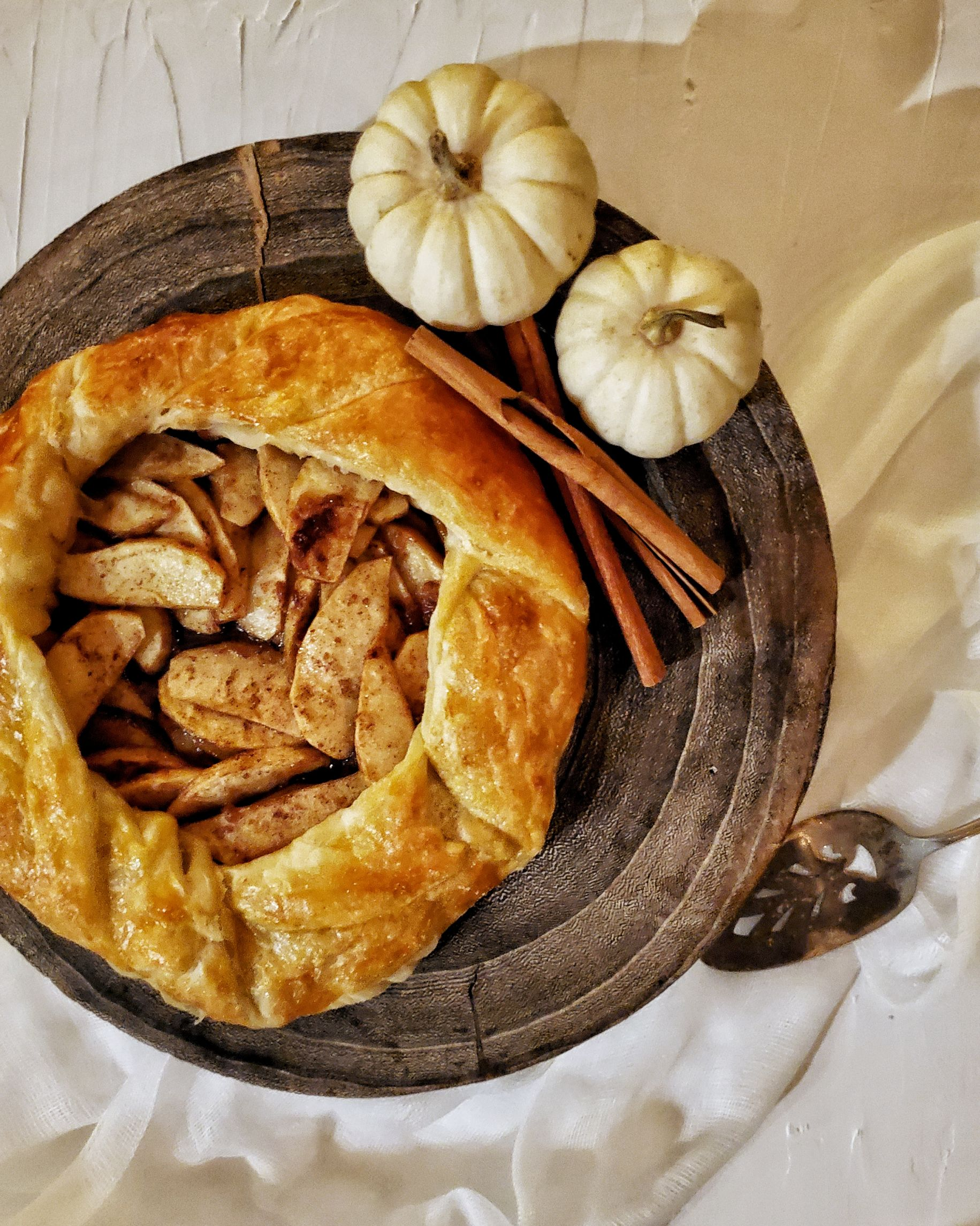 Apple galette on decorative cake stand