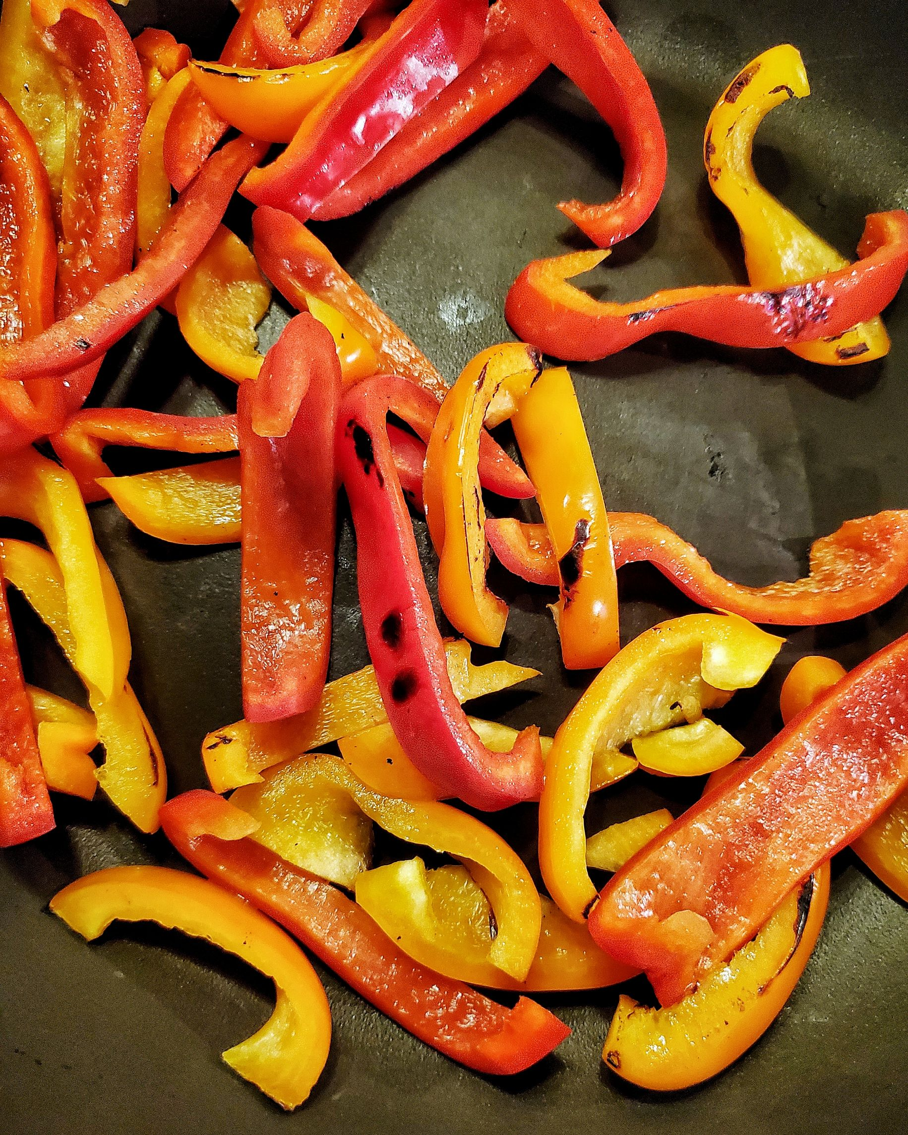 charred peppers in pan
