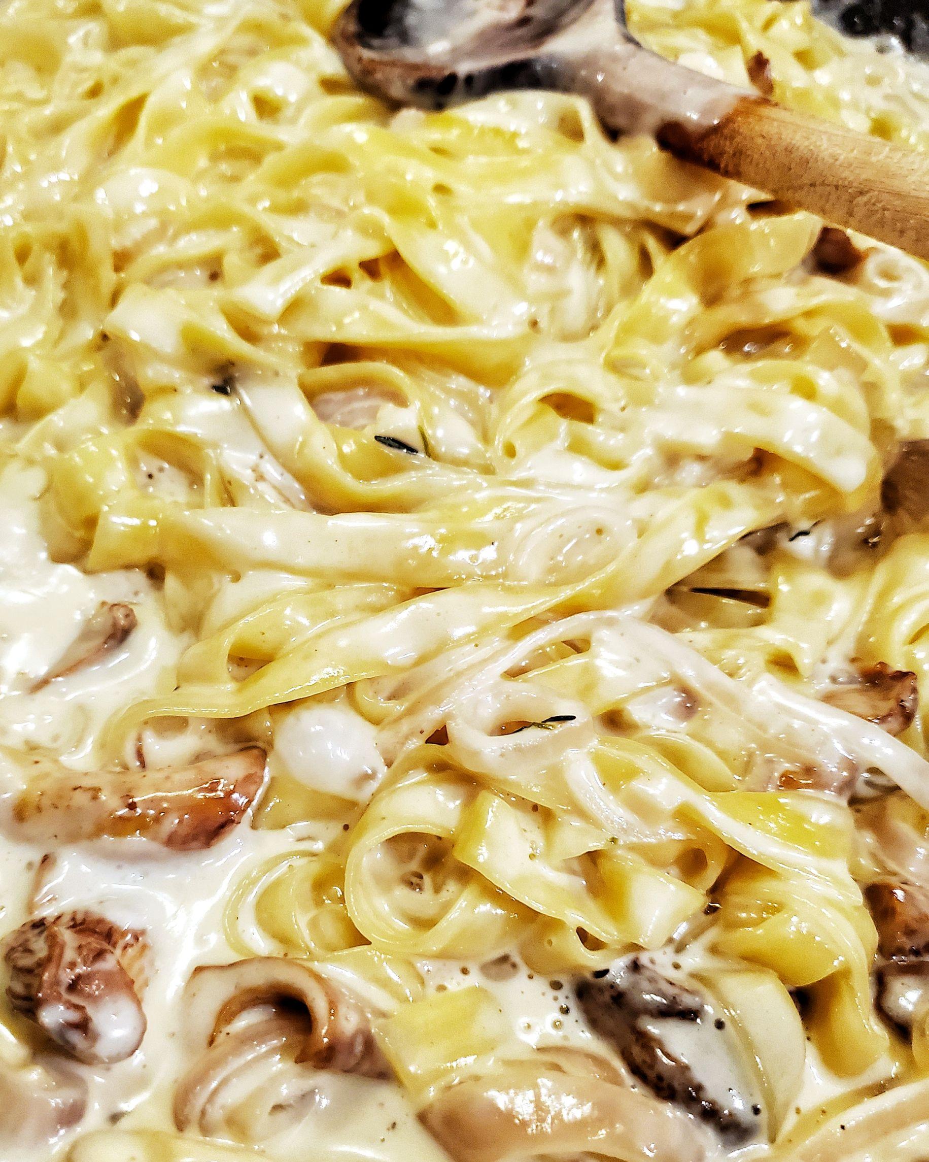 Creamy chanterelle pasta in skillet