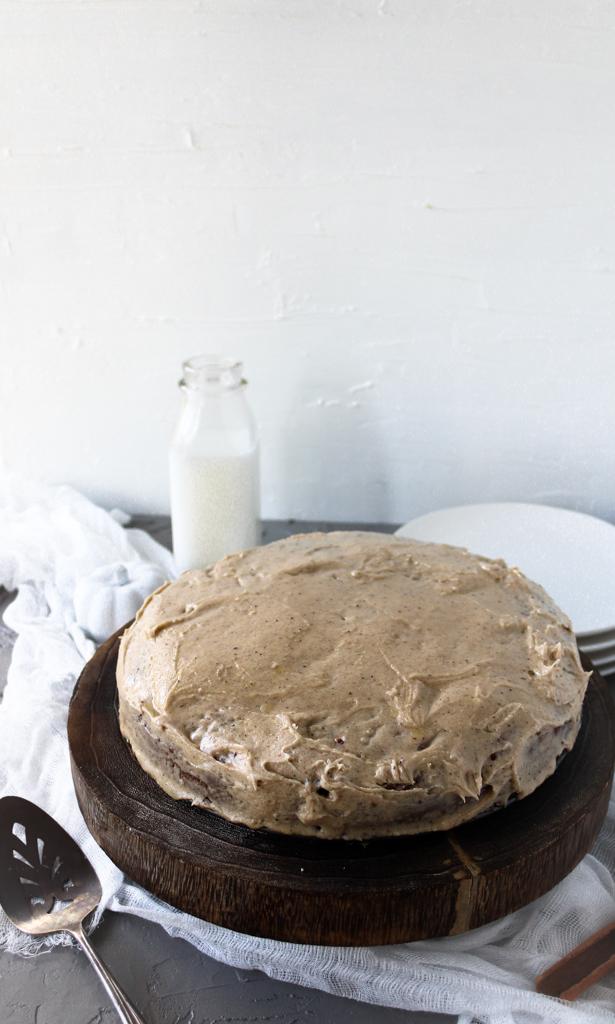 pumpkin bourbon cake with brown butter icing on platter