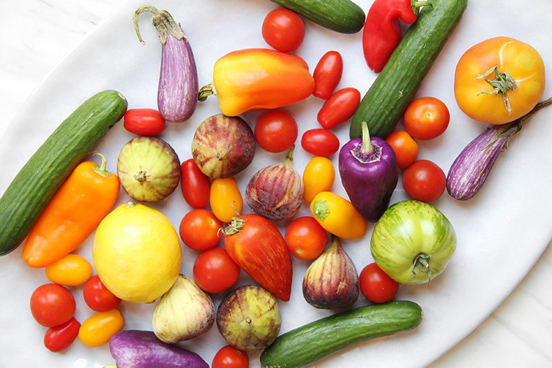 Colorful summer vegetables and fruit on a platter