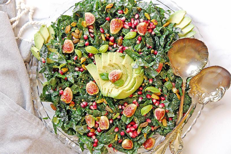 California Harvest Salad on a serving platter, with serving utensils
