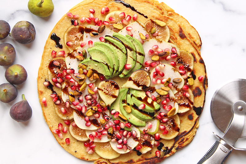 California Harvest Flatbread from above, with fresh figs and a pizza slicer