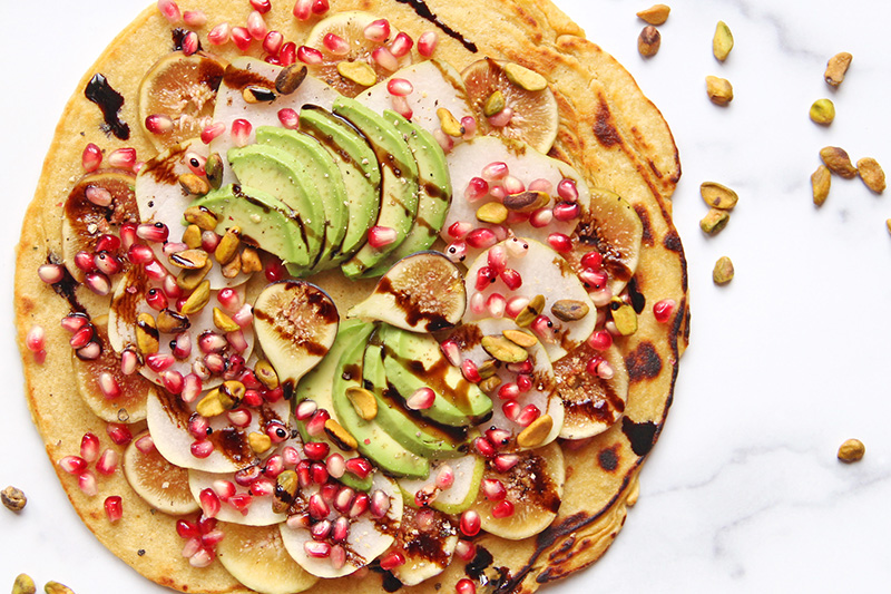 California Harvest Flatbread from above, with scattered pistachios