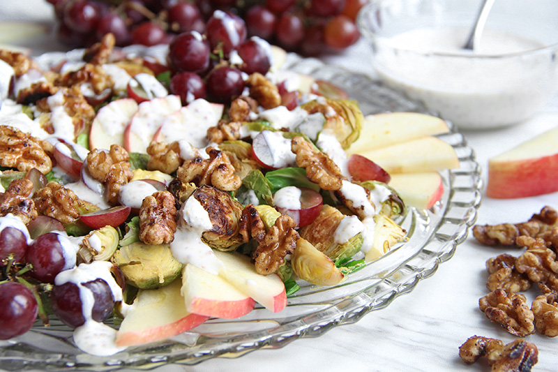 Side-view of Roasted Brussel Sprout Waldorf Salad on a platter