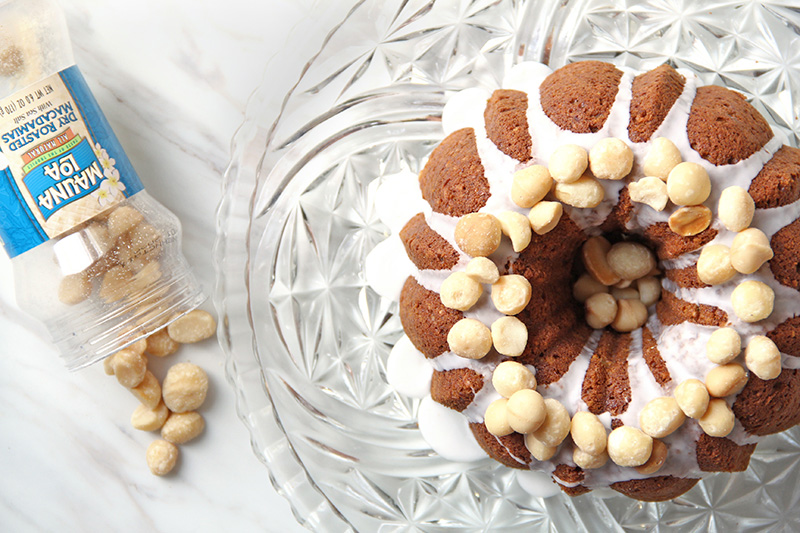 Pumpkin bundt cake topped with macadamia nuts, shown from above