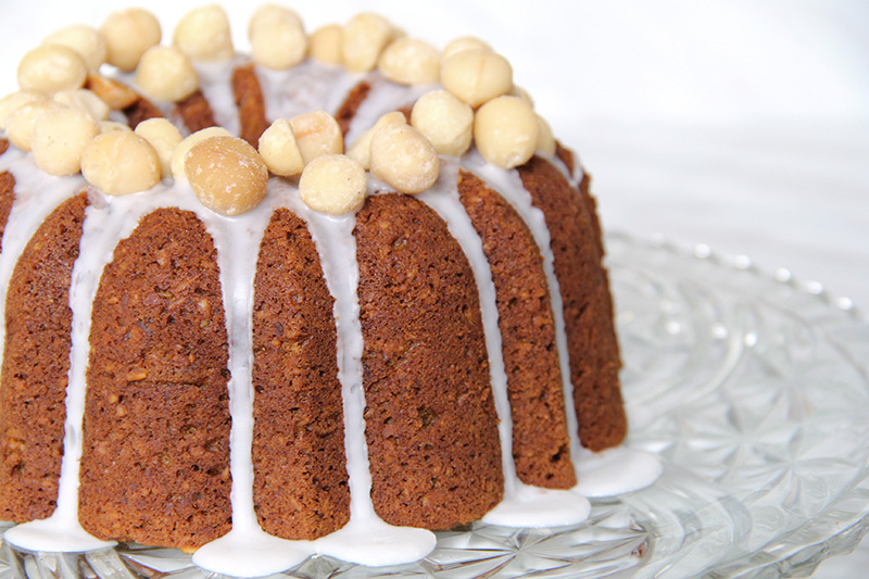 Close-up of pumpkin bundt cake topped with macadamia nuts