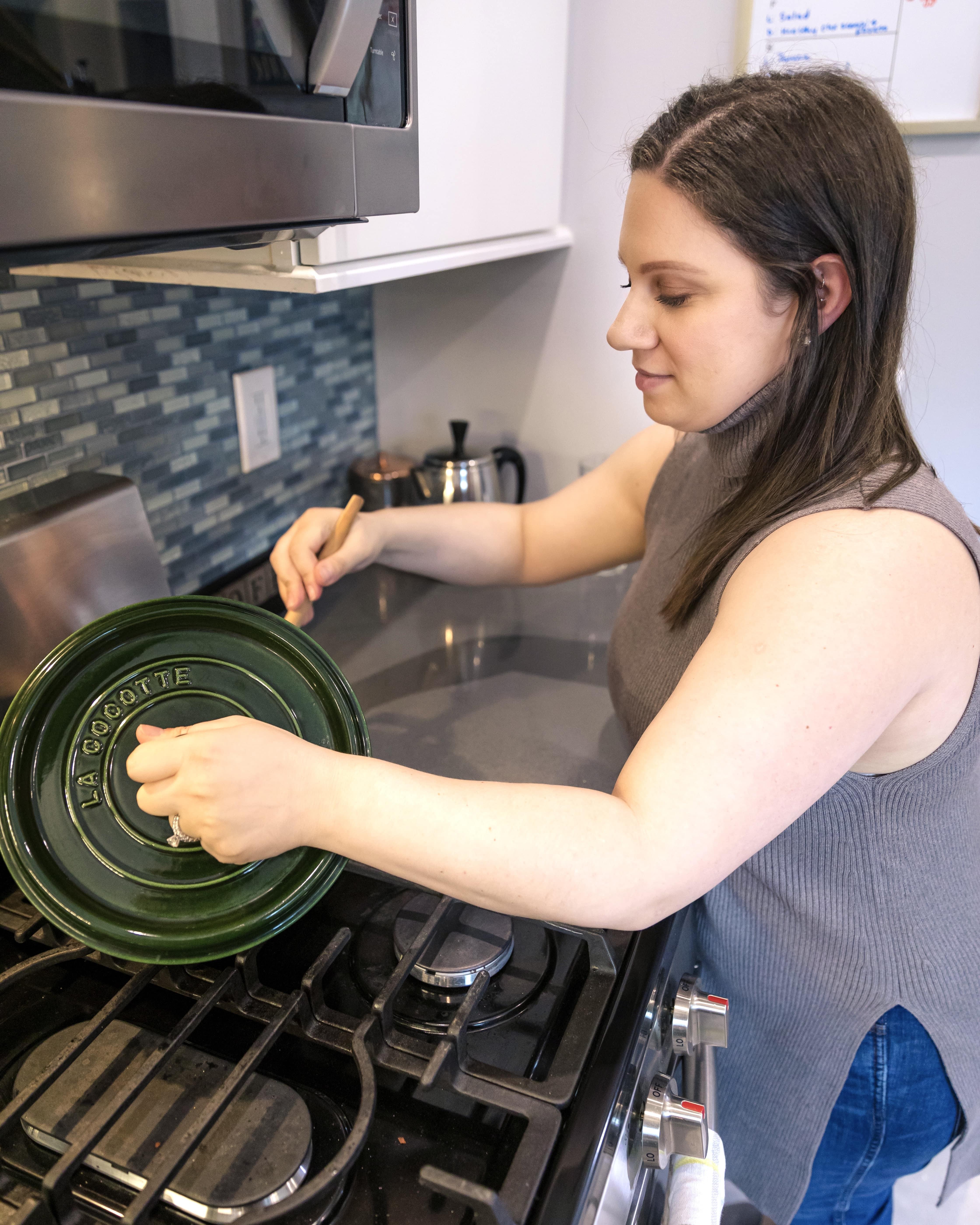 morgan at stove stirring in a pot