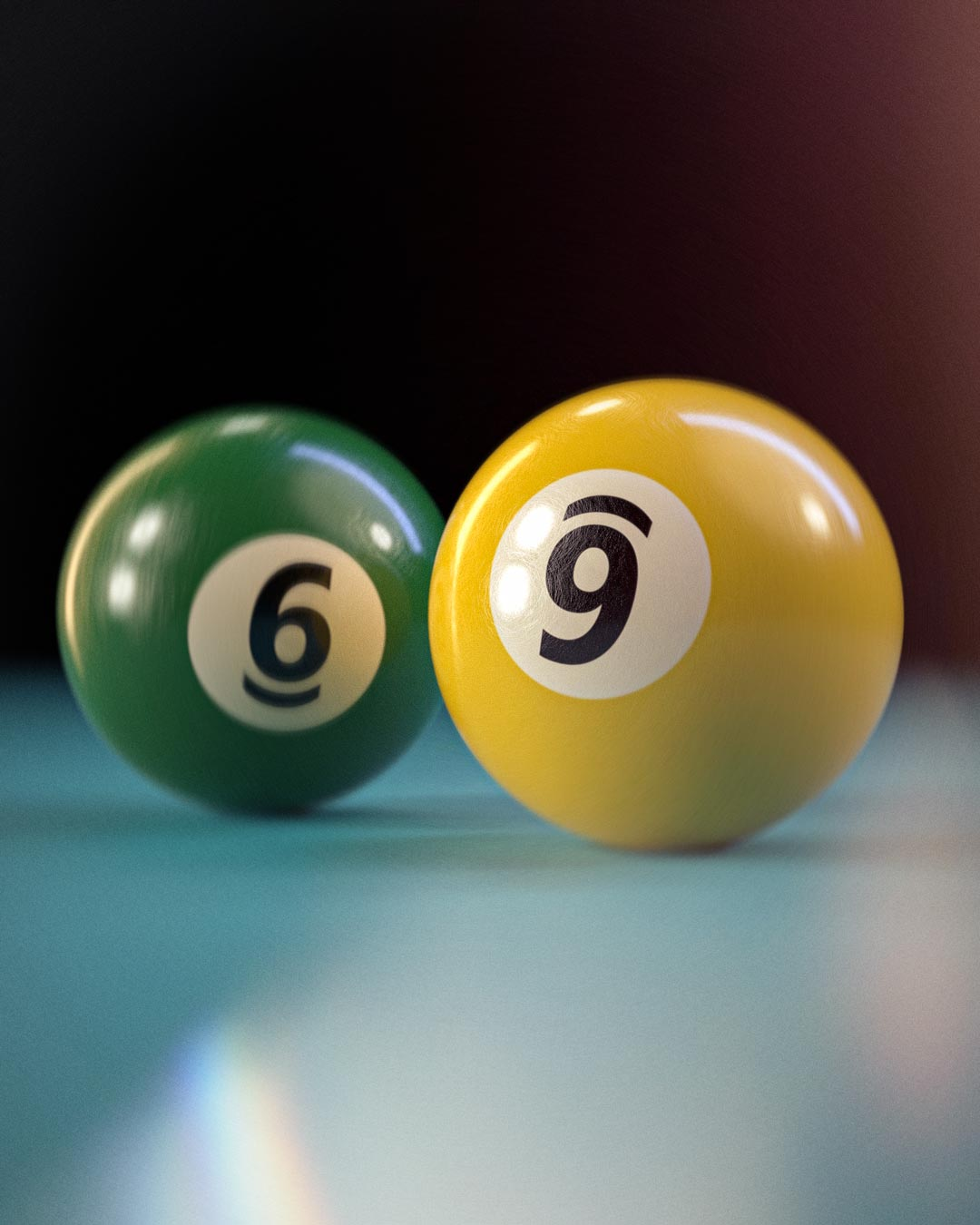 pool balls with numbers 6 and 9 side by side