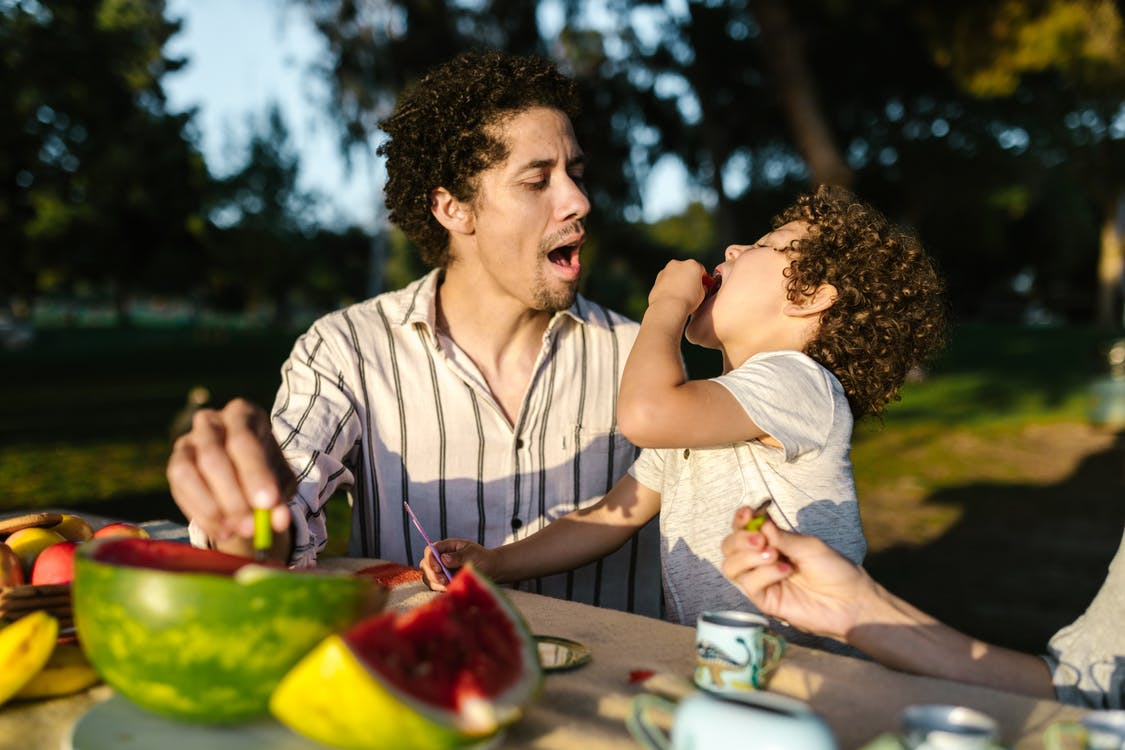 Dad praising son for trying new food