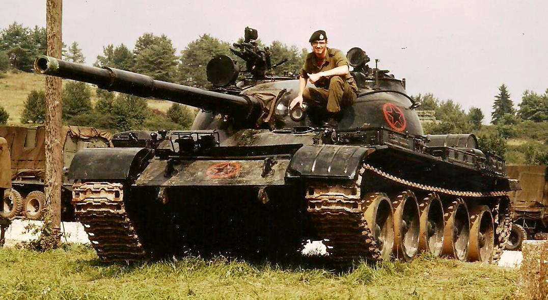 Hal with a Soviet-built T-62 tank, at Hohenfels training centre, Germany