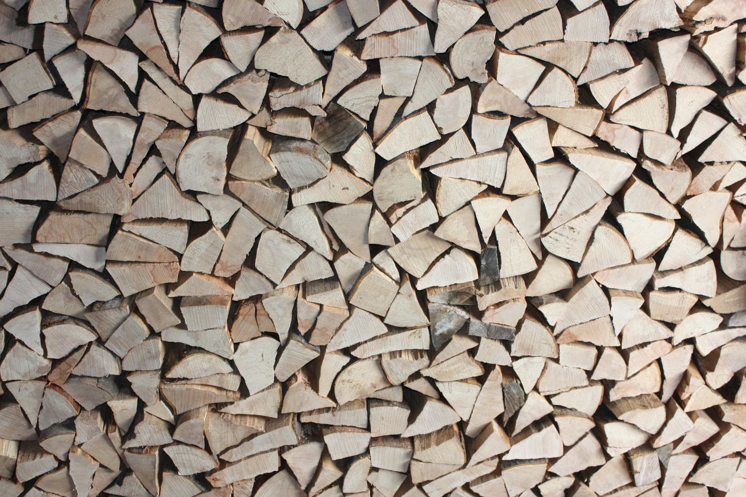 Some wood split into logs ready to burn on a Stove.