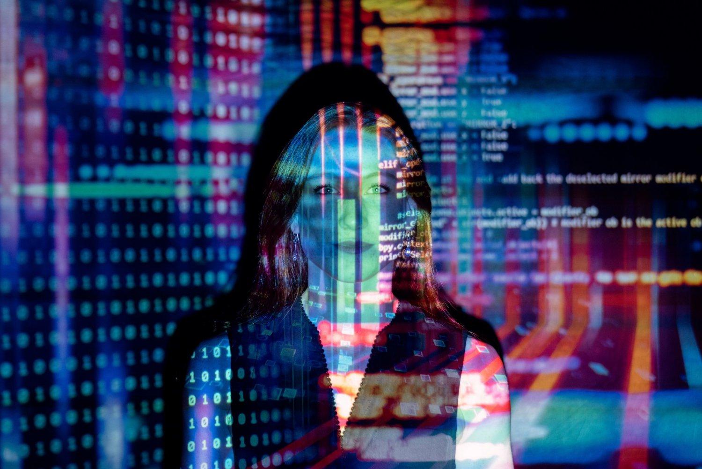 computer code across a woman's face