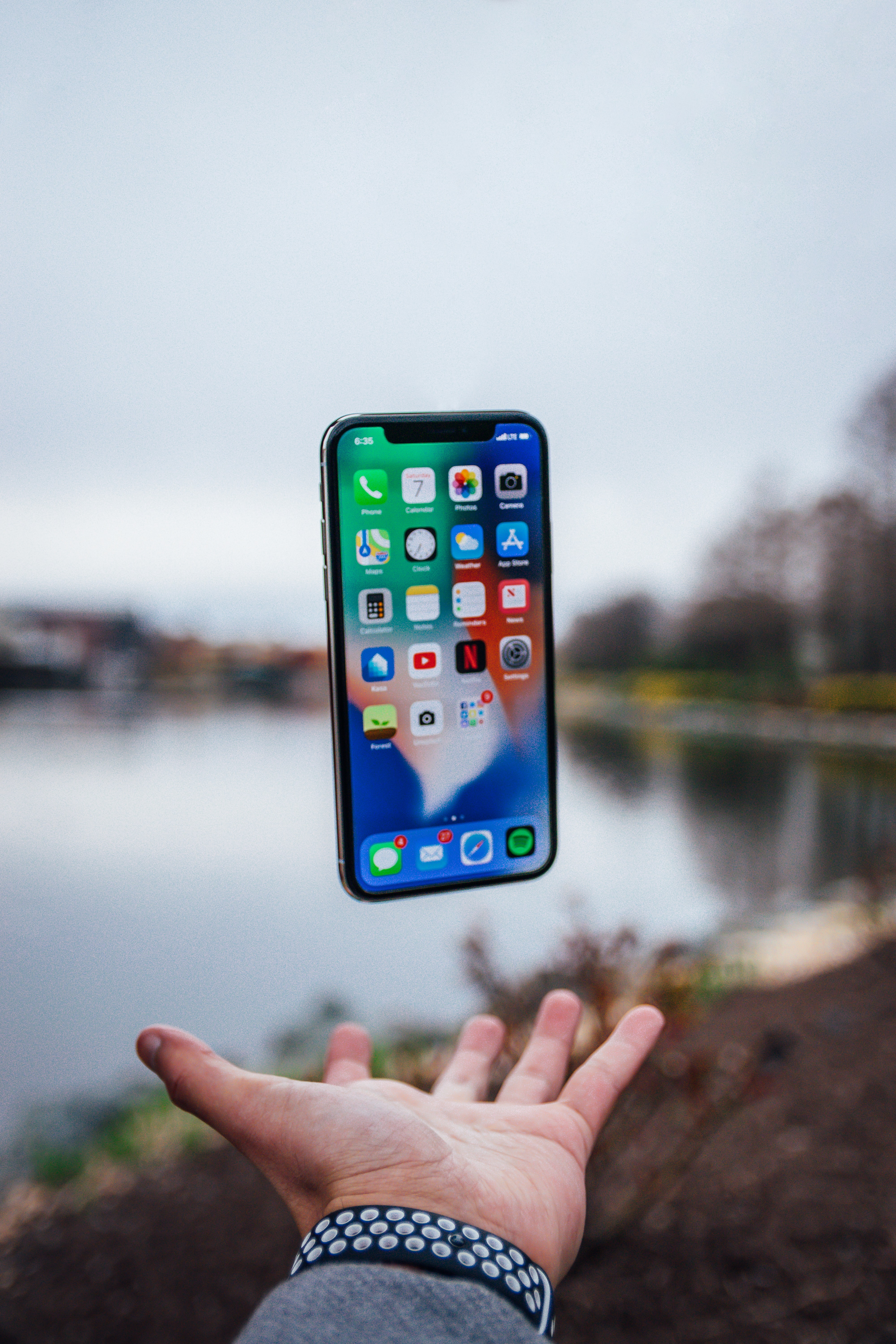 POV of iPhone floating above a person's hand