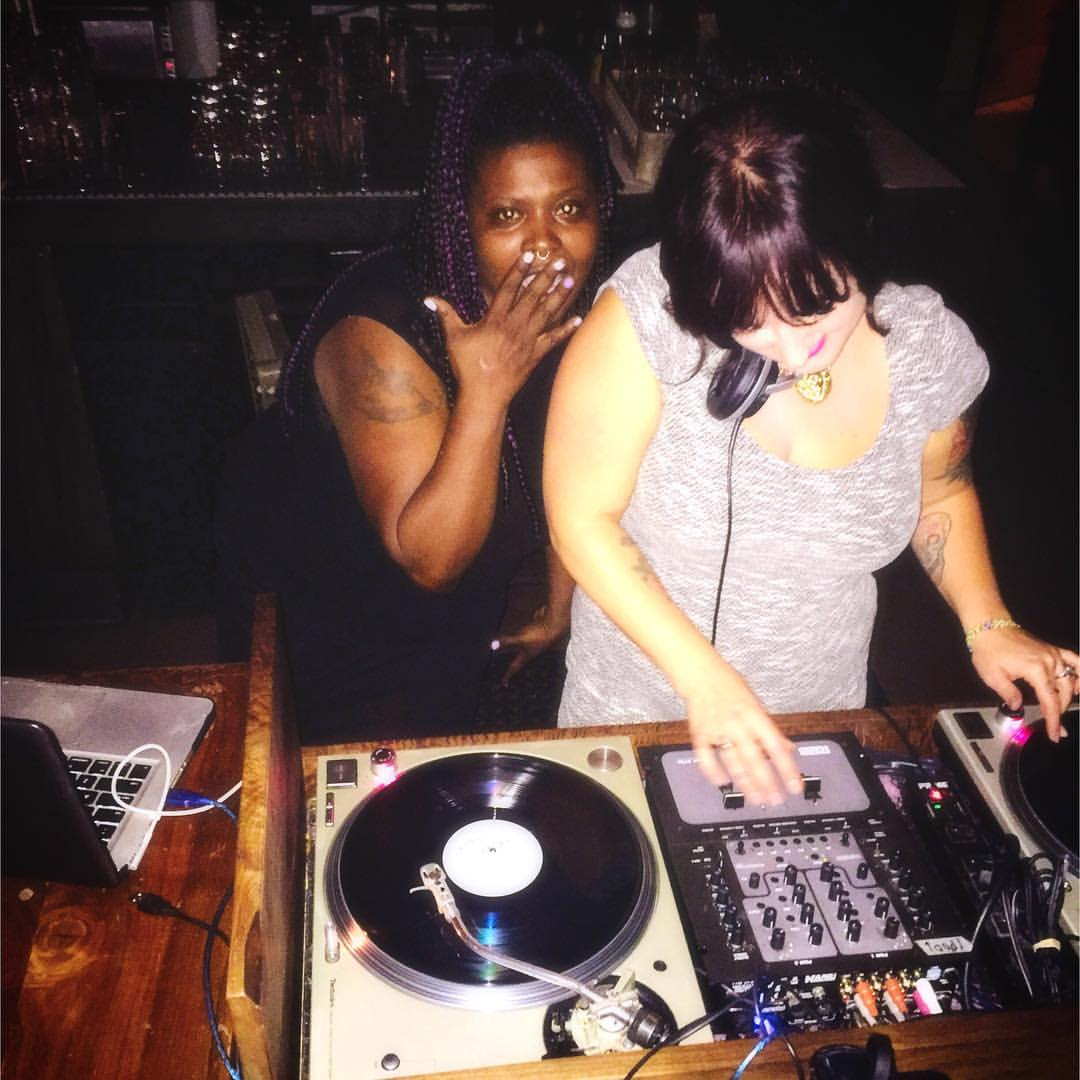 Two women DJing at Dig A Pony