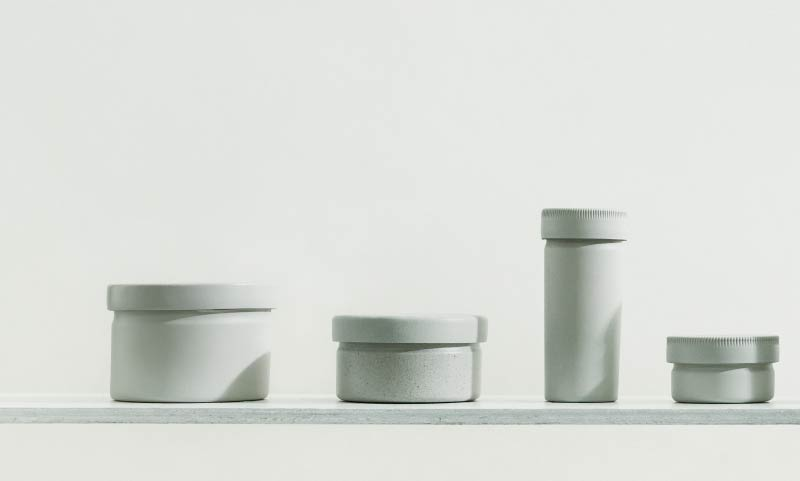 A lineup of Shellworks products in a uniform grey including jars and dropper forms.