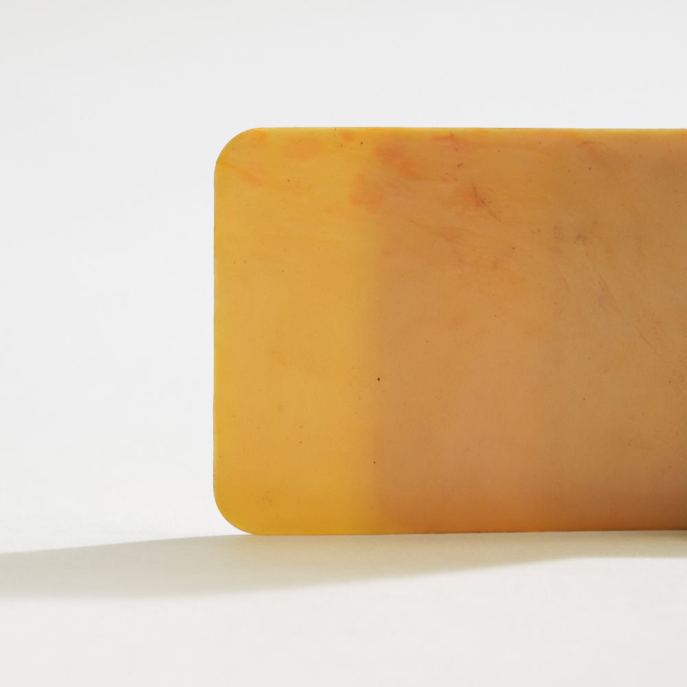Shellworks material plaque - yellow colour with speckles of orange.