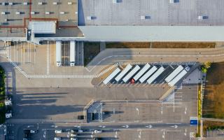 Overhead photo of a trucking logistics center.