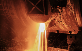 Molten metal pouring out of a furnace.