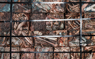 Scrap metal compressed and bundled for recycling.